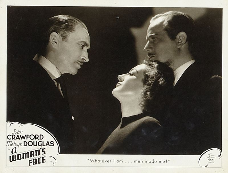 A Woman's Face Lobby Card - Conrad Veidt, Joan Crawford, and Melvyn Douglas