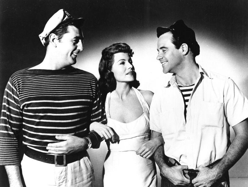 Robert Mitchum, Rita Hayworth, and Jack Lemmon