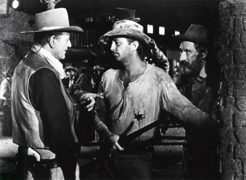 John Wayne, Robert Mitchum, and Arthur Hunnicutt