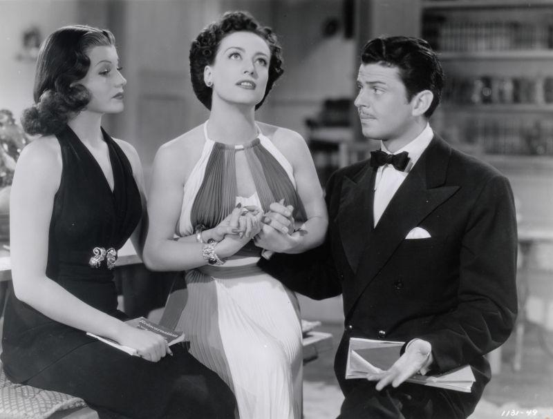 Rita Hayworth, Joan Crawford, and John Carroll in Susan and God